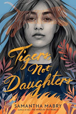 The cover of Tigers Not Daughters features a Latinx young woman with her hair blowing in the breeze. A transparent tiger is jumping across the picture in a way that maker her look like she is wearing a mask. There are plants at the bottom and what seems to be orange flames.