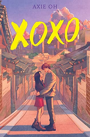 XOXO book cover. A young woman and young man are standing facing each other with arms loosely around each others' waists. Along the sides of the street are Korean hanok style houses. In the background is a city scape with skyscrapers. style