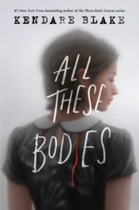 A young woman is standing with her back to the reader on this book cover. There is blood dripping down her back from the collar of her dress.