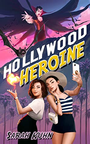 Book cover shows two women taking a selfie. One has fire in her hand. There is also a man on a roof with a cape that looks a bit like a vampire.