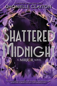 Book cover has the title and it also says a mirror novel. The center is very dark purple and the edges of the book have light purple feathers, jewelry and other items.