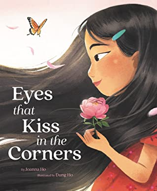 Young girl with long dark flowing hair is smiling and holding a flower in one hand. She is in profile and her eye is round at the front near her nose and comes to a small point by her temple. There is a butterfly in the air above her hair. The title of the book is Eyes That Kiss in the Corners