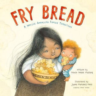 A woman has a young child in one arm and a bowl full of fry bread in the other on this book cover